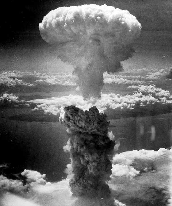The mushroom shaped cloud hang on Hiroshima. August 6, 1945.
