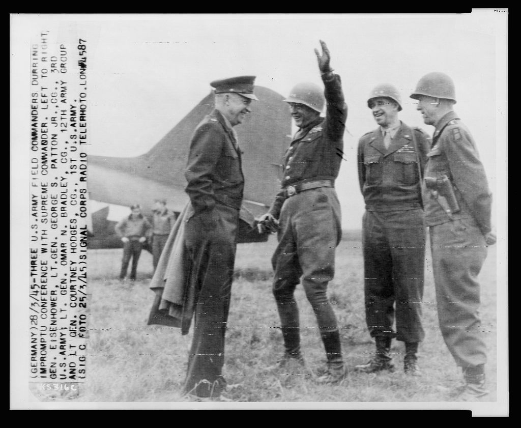 General George Patton (raising his hand); March 1945; General's Eisenhower, Bradley.