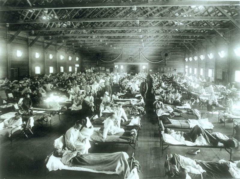Camp Funston, Kansas, 1918, rows of sick influenza patients.
