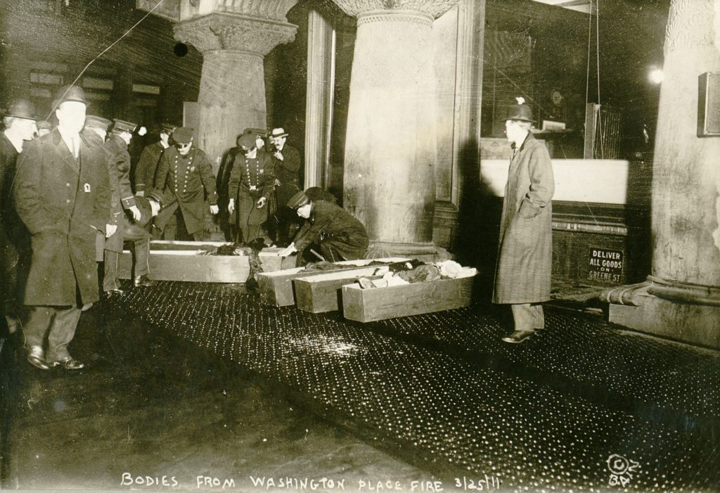 Triangle Shirtwaist Fire, March 1911, on the sidewalk are coffins containing the bodies of some of the young women who died in the tragic fire.